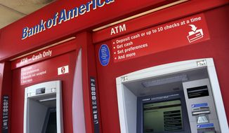 FILE - This  July 18, 2016, file photo shows a Bank of America ATM in Woburn, Mass. Bank of America Corp. reports financial results, Tuesday, July 18, 2017. (AP Photo/Elise Amendola, File)