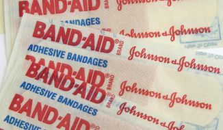 FILE - This Tuesday, Sept. 13, 2016, file photo, shows Johnson & Johnson Band-Aid brand bandages in Surfside, Fla. Johnson & Johnson reports financial earnings Tuesday, July 18, 2017. (AP Photo/Wilfredo Lee, File)