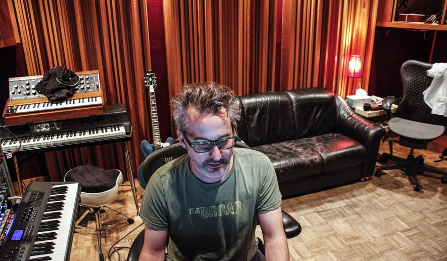 In this June 30, 2017 photo, John Fields, an accomplished music producers who  currently works alongside Steve Weise, works in a recording studio in Minneapolis. Digital technology has revolutionized the business and dramatically dropped the entry costs to produce high-quality music. And the big studios that drove so much music success here and across the country are under immense competitive pressure. (Maria Alejandra Cardona/Minnesota Public Radio via AP)