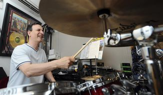 """In this Tuesday, July 11, 2017 photo, Mario Socci plays the drums while practicing with his band Eight-Track Playback in his backyard studio in Stamford, Conn. The band will be performing in the Italian town of Settefrati during the festival of Madonna di Canneto, where many of the band's family are from, and will be hits popular in Italy and songs, including  """"Sympathy for the Devil"""" by The Rolling Stones and """"Highway to Hell"""" by AC/DC. (Michael Cummo/Hearst Connecticut Media via AP)"""