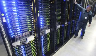In this Oct. 15, 2013, file photo, Chuck Goolsbee, site director for Facebook's Prineville data centers, shows the computer servers that store users' photos and other data, at the Facebook site in Prineville, Ore. Facebook is making good on plans to expand its high-tech data center already under construction in central New Mexico. Gov. Susana Martinez's office announced early Tuesday, July 18, that the company will build a second building at the site near Los Lunas, just south of Albuquerque. (Andy Tullis/The Bulletin, via AP, File)