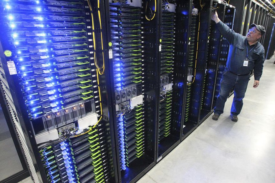 In this Oct. 15, 2013, file photo, Chuck Goolsbee, site director for Facebook's Prineville data centers, shows the computer servers that store users' photos and other data, at the Facebook site in Prineville, Oregon. (Andy Tullis/The Bulletin, via AP, File) **FILE**