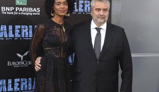 "In this July 17, 2017 photo, producer Virginie Besson Silla and director Luc Besson arrive at the LA Premiere of ""Valerian and the City of a Thousand Planets"" in Los Angeles. (Photo by Jordan Strauss/Invision/AP)"