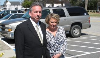 FILE - In a Monday, March 9, 2015 file photo, Richard and Elizabeth Jones, whose daughter was killed by a train on a Georgia movie set in 2014, speak with reporters outside the Wayne County Courthouse, in Jesup, Ga., after the film's director and executive producer pleaded guilty to charges of involuntary manslaughter and criminal trespassing. A railroad owner must pay $3.9 million to the family of of Sarah Jones, a movie worker killed on a Georgia railroad trestle in 2014, a jury decided Monday, Juky 17, 2017, in a civil verdict that found the company shared in the blame for the deadly freight train collision even though the film crew was trespassing. (AP Photo/Russ Bynum, File)