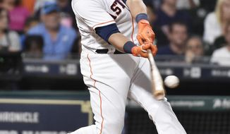 Houston Astros' Carlos Beltran hits a two-run home run off Seattle Mariners starting pitcher Ariel Miranda during the sixth inning of a baseball game, Monday, July 17, 2017, in Houston. (AP Photo/Eric Christian Smith)