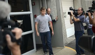FILE - In this Aug. 16, 2013, file photo, Speck Mellencamp, center, leaves the Monroe County Jail after being booked in and bonded out of jail in Bloomington, Ind. Police say 22-year-old Mellencamp, a son of rock star John Mellencamp, was arrested early Sunday, July 16, 2017, after he and his 23-year-old brother, Hud, were involved in a fight outside a Bloomington restaurant. (Chris Howell/The Herald-Times via AP, File)