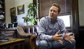 Montana Gov. Steve Bullock talks with reporters in his office in the State Capitol in Helena, Mont., Tuesday, July 18, 2017. Bullock said he is seeking to add his voice to the national conversation on health care, public lands and a host of other issues. But he says any speculation about a presidential bid or a run for the U.S. Senate in 2020 is premature. (Thom Bridge/Independent Record via AP)