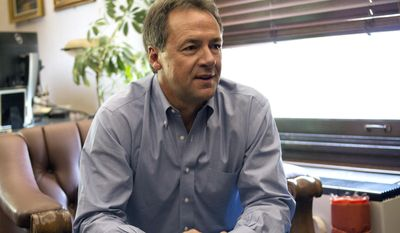 Montana Gov. Steve Bullock meets with reporters in his Capitol office in Helena, Mont., Tuesday, July 18, 2017, to discuss his decision to launch a national fundraising committee, even as he downplays his ambitions for national political office. Bullock says his committee, Big Sky Values, will help raise money to pay for his travel for political appearances across the country. (AP Photo/Bobby Calvan