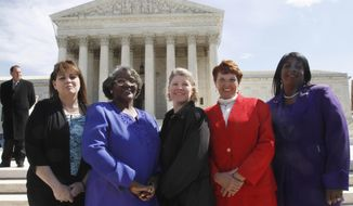 FILE - In this March 29, 2011 file photo, the five plaintiffs in a case of women employees against Wal-Mart, from left, Stephanie Odle, of Norman, Okla., Betty Dukes, of Pittsburg, Calif., Deborah Gunter, of Palm Springs, Calif., Christine Kwapnoski, of Bay Point, Calif., and Edith Arena, of Duarte, Calif. pose for a photograph outside the Supreme Court in Washington. Dukes, a Walmart greeter who took the retail giant all the way to the U.S. Supreme court in the largest gender bias class-action lawsuit in U.S. history, died July 10. 2017, at her home in Antioch, Calif., said her niece Rita Roland. she was 67. (AP Photo/Jacquelyn Martin, File)