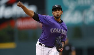 Colorado Rockies starting pitcher German Marquez delivers a pitch to San Diego Padres' Manuel Margot during the first inning of a baseball game Monday, July 17, 2017, in Denver. (AP Photo/David Zalubowski)