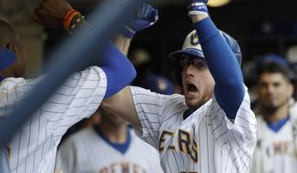 Milwaukee Brewers' Brett Phillips celebrates his two-run home run during the fifth inning of a baseball game against the Philadelphia Phillies Sunday, July 16, 2017, in Milwaukee. (AP Photo/Morry Gash)