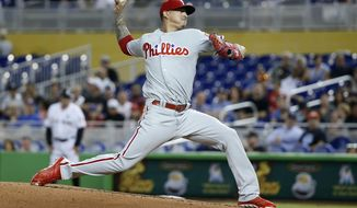 Philadelphia Phillies' Vince Velasquez delivers a pitch during the first inning of a baseball game against the Miami Marlins, Tuesday, July 18, 2017, in Miami. (AP Photo/Wilfredo Lee)