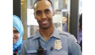 In this May 2016 image provided by the City of Minneapolis, police officer Mohamed Noor poses for a photo at a community event welcoming him to the Minneapolis police force. Noor, a Somali-American, has been identified by his attorney as the officer who fatally shot Justine Damond, of Australia, late Saturday, July 15, 2017, after she called 911 to report what she believed to be an active sexual assault. (City of Minneapolis via AP)