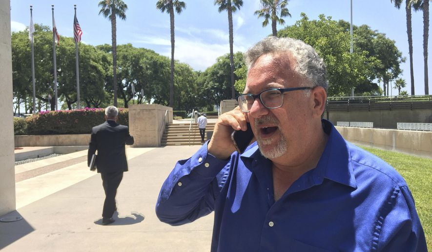 Professor Eric Canin is pictured in Long Beach, Calif., outside a meeting of the California State University Fullerton board of trustees on Tuesday, July 18, 2017. Canin has been reinstated at the school after he faced being fired over a run-in with pro-Donald Trump student demonstrators in Feb. 2017. (AP Photo/Amanda Lee Meyers)