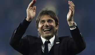 "FILE - In this Monday, May 15, 2017 file photo, Chelsea's manager Antonio Conte celebrates after the English Premier League soccer match between Chelsea and Watford at Stamford Bridge stadium in London. Conte has signed a new two-year contract with the English Premier League champions. ""I am very happy to have signed a new contract with Chelsea,"" Conte said on the club's website on Tuesday, July 18, 2017.  (AP Photo/Matt Dunham, File)"