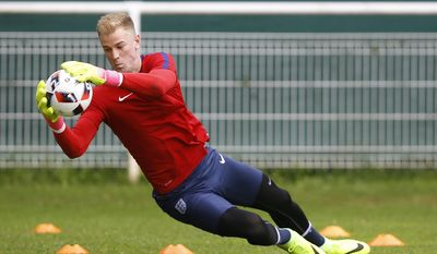 FILE - In this Sunday, June 26, 2016 file photo, England's goalkeeper Joe Hart makes a save during a training session in Chantilly, France. England goalkeeper Joe Hart has completed Wednesday, Aug. 31, 2016, a loan move to Torino from Manchester City. England goalkeeper Joe Hart has joined West Ham on season-long loan it was announced on Tuesday, July 18, 2017, after finding no way back into the Manchester City team under Pep Guardiola. Hart was the first-choice goalkeeper as City won the Premier League in 2012 and 2014. (AP Photo/Kirsty Wigglesworth, File)