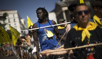 Protesters carry depictions of razor wire along the border separating two Spanish enclaves from relentless waves of migrants seeking to escape from the desperate poverty, terrorist violence, criminal bureaucracy and chaos of their sub-Saharan and North African countries. (Associated Press/File)
