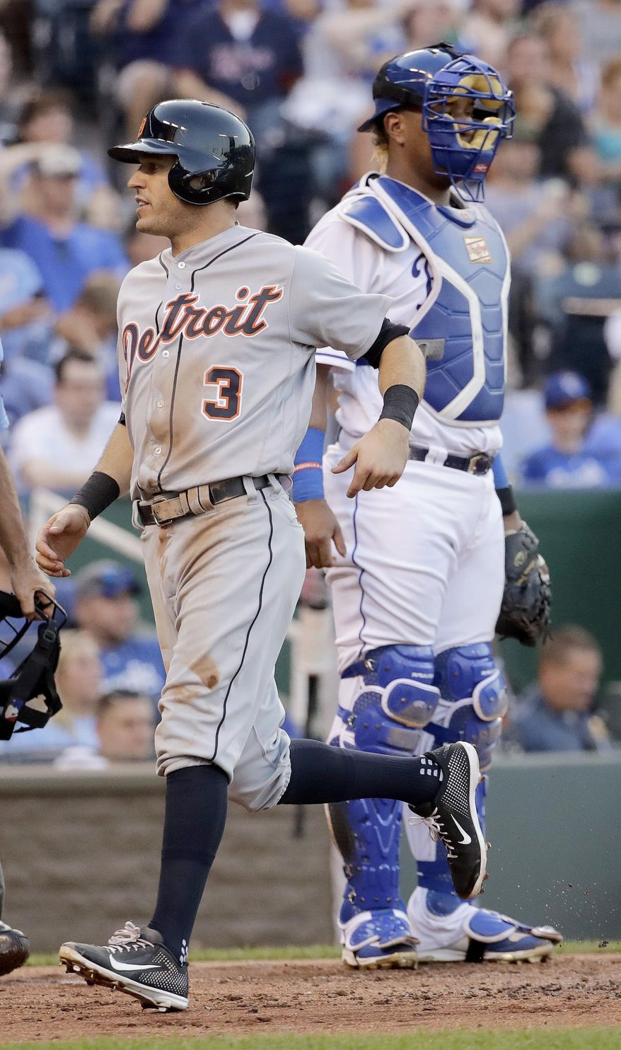 Detroit Tigers' Ian Kinsler (3) crosses the plate in front of Kansas City Royals catcher Salvador Perez to score on a two-run triple by Nicholas Castellanos during the second inning of a baseball game Tuesday, July 18, 2017, in Kansas City, Mo. (AP Photo/Charlie Riedel)