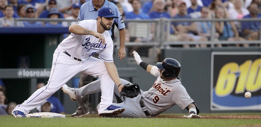 Detroit Tigers' Nicholas Castellanos (9) beats the tag at third by Kansas City Royals third baseman Mike Moustakas after hitting a two-run triple during the second inning of a baseball game Tuesday, July 18, 2017, in Kansas City, Mo. (AP Photo/Charlie Riedel)