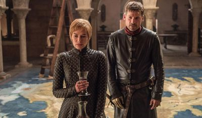 """This image released by HBO shows Lena Headey, left, and Nikolaj Coster-Waldau in """"Game of Thrones,"""" which premiered its seventh season on Sunday, July 16. (Helen Sloan/HBO via AP)"""