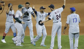 FILE - In this July 11, 2017 photo, American League teammates celebrate winning the MLB baseball All-Star Game in Miami. The American League defeated the National League 2-1 in ten innings. Seattle Mariners Robinson Cano (22), third from right, hit the game winning home run. (AP Photo/Wilfredo Lee)