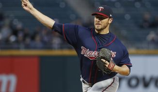 FILE - In this April 7, 2017, file photo, Minnesota Twins starting pitcher Phil Hughes throws against the Chicago White Sox during a baseball game in Chicago. Hughes will miss the rest of the season because of persistent arm trouble related to a condition that required rib removal surgery a year ago. The Twins put Hughes on the 60-day disabled list Tuesday, July 18, and manager Paul Molitor said another operation is possible. (AP Photo/Kamil Krzaczynski, File)