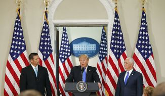 President Donald Trump, with Kansas Secretary of State Kris Kobach, left, and Vice President Mike Pence, right, speaks at a meeting of the Presidential Advisory Commission on Election Integrity, Wednesday, July 19, 2017, in the Eisenhower Executive Office Building on the White House complex in Washington. (AP Photo/Pablo Martinez Monsivais)