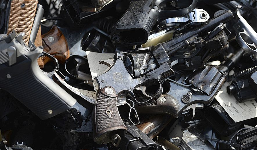 Guns to be melted into metal reinforcing bars for use in construction are stacked in a pile at Gerdau Steel Mill Wednesday, July 19, 2017, in Rancho Cucamonga, Calif. Nearly 5,000 weapons seized or collected by the Los Angeles County Sheriff's Department were destroyed in the agency's annual gun melt. The handguns, rifles and semi-automatic weapons were dumped into the steel mill's furnace. (Rick Sforza/Los Angeles Daily News via AP)