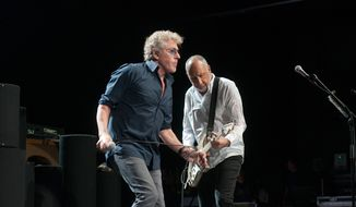 Roger Daltrey (left) and Pete Townshend, the two surviving original members of The Who, perform at The Theater at MGM National Harbor in Oxon Hill, Maryland, July 18, 2017.  (Erica Bruce/Special to The Washington Times)