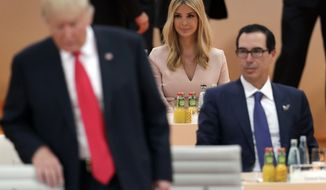 In this Saturday, July 8, 2017, file photo, Ivanka Trump, daughter of U.S. President Donald Trump, left, attends a working session at the G-20 summit in Hamburg, northern Germany. (AP Photo/Michael Sohn, File)