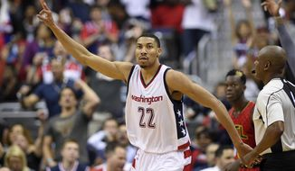 FILE - In this April 26, 2017 file photo, Washington Wizards forward Otto Porter Jr. (22) gestures after his 3-pointer during the second half in Game 5 of the team's first-round NBA basketball playoff series against the Atlanta Hawks in Washington. Porter's $106 million, four-year contract solidifies his spot as part of the Washington Wizards' core and also, temporarily, makes him their highest-paid player ahead of John Wall and Bradley Beal.  (AP Photo/Nick Wass, File)