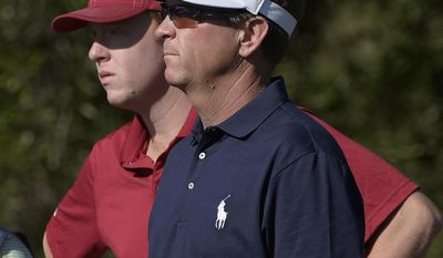FILE - In this Dec. 13, 2014, file photo, Davis Love III, front, and his son, Dru Love, wait to hit their tee shots on the second hole during the first round of the Father/Son Challenge golf tournament in Orlando, Fla. Davis Love III will be playing against his son, Dru, in this weeks Barbasol Championship in Opelika, Ala. (AP Photo/Phelan M. Ebenhack, File)