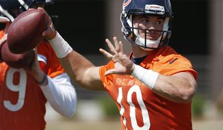 FILE - In this May 12, 2017, file photo, Chicago Bears quarterback Mitchell Trubisky looks to pass during NFL football rookie minicamp in Lake Forest, Ill. The Bears have signed Trubisky, their first-round draft pick and the No. 2 overall selection in April, the team announced Wednesday, April 19, 2017.  (AP Photo/Nam Y. Huh, File)