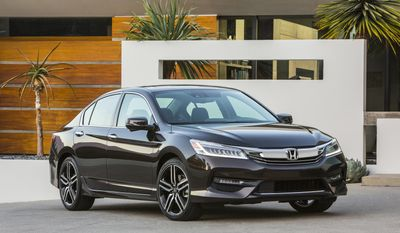 This photo provided by Honda shows the 2017 Accord midsize sedan which is scheduled to be replaced with an all-new model in fall 2017. Edmunds predicts that the current model will become heavily discounted once the new Accord starts arriving on dealer lots. Although the new model will be more fuel-efficient and offer additional features, the current model is still a top-rated family vehicle worth considering. (Courtesy of American Honda Motor Co., Inc. via AP)