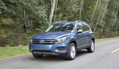 This photo provided by Volkswagen shows the 2017 Tiguan compact SUV. A new, much larger version of the Tiguan arrives in fall 2017 which means the 2017 model will likely become heavily discounted. Edmunds suggests considering the current Tiguan if you don't need the three rows of seating offered in the new model. (Daniel Byrne/Courtesy of Volkswagen of America, Inc. via AP)