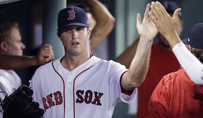 Boston Red Sox starting pitcher Drew Pomeranz is congratulated by teammates after being taken out of the game during the seventh inning at Fenway Park in Boston, Wednesday, July 19, 2017. Pomeranz allowed three hits in his outing. (AP Photo/Charles Krupa)