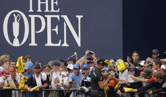 Sweden's Henrik Stenson signs autographs after a practice round ahead of the British Open Golf Championship, at Royal Birkdale, Southport, England Wednesday, July 19, 2017. (AP Photo/Alastair Grant)