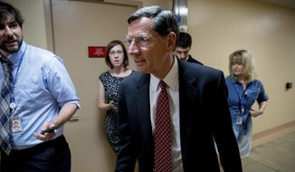 Sen. John Barrasso, R-Wyo., walks into the Capitol Building on Capitol Hill in Washington, Monday, July 17, 2017. (AP Photo/Andrew Harnik) ** FILE **