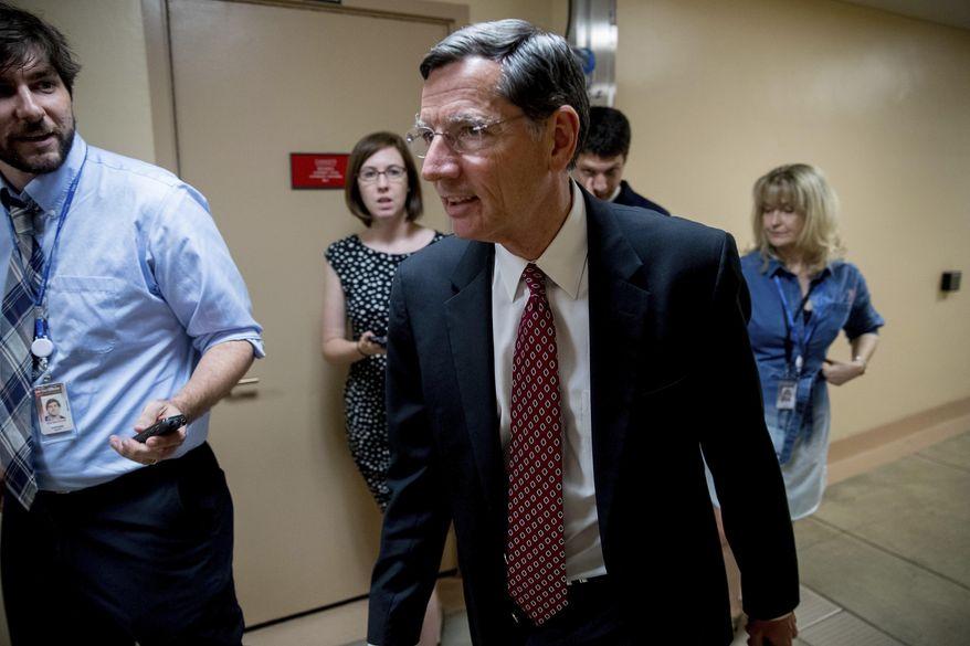 Sen. John Barrasso, R-Wyo., walks into the Capitol Building on Capitol Hill in Washington, Monday, July 17, 2017. (AP Photo/Andrew Harnik) ** FILE **
