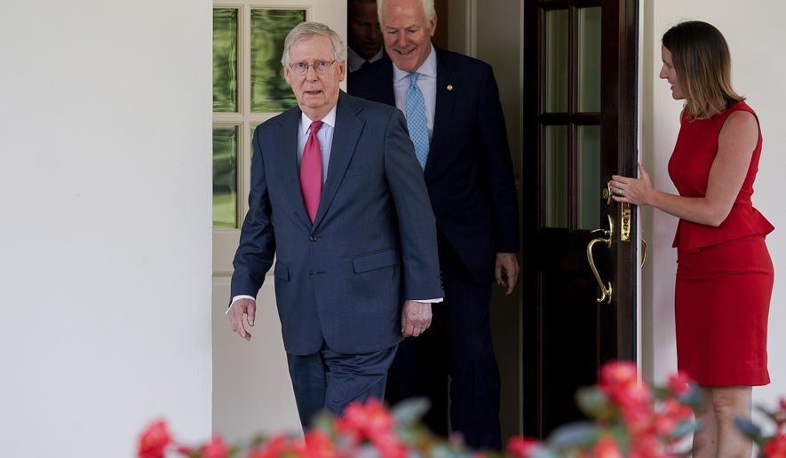 Senate Majority Leader Mitch McConnell of Ky., followed by Senate Majority Whip John Cornyn Texas, leave the White House in Washington, Wednesday, July 19, 2017, to speak to members of the media following a luncheon with President Donald Trump and other GOP leadership. (AP Photo/Andrew Harnik)