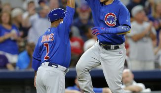 Chicago Cubs' Willson Contreras (40) celebrates with third base coach Gary Jones as he rounds the bases after hitting a three-run home run during the third inning of the team's baseball game against the Atlanta Braves on Tuesday, July 18, 2017, in Atlanta. (AP Photo/John Bazemore)