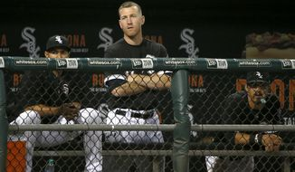 Chicago White Sox third baseman Todd Frazier watches his team during the ninth inning a baseball game against the Los Angeles Dodgers on Tuesday, July 18, 2017, in Chicago. The Dodgers won 1-0. (AP Photo/Charles Rex Arbogast)