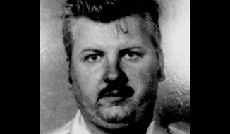FILE - This 1978 file photo shows serial killer John Wayne Gacy. Cook County Sheriff Sheriff Tom Dart plans to provide an update on a years long effort to identify unnamed victims of Gacy Wednesday, July 19, 2017 in Chicago. Dart will discuss the investigation that he launched in 2011. His office exhumed the skeletal remains of eight of at least 33 young men Gacy stabbed or strangled in the 1970s. (AP Photo/File)