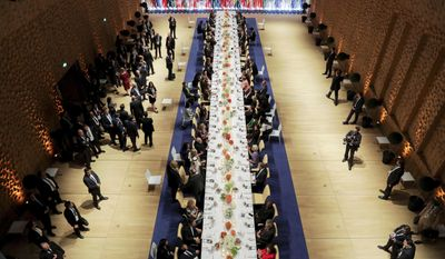 In this July 7, 2017 photo the heads of government of the G-20 states and their partners have dinner after a concert in the Elbphilharmonie concert hall in Hamburg, Germany (Kay Nietfeld/Pool Photo via AP)
