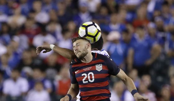 United States' Paul Arriola (20) and El Salvador's Victor Garcia (17) jump for a header during a CONCACAF Gold Cup quarterfinal soccer match in Philadelphia, Wednesday, July 19, 2017. (AP Photo/Matt Rourke)