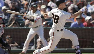 San Francisco Giants' Buster Posey hits a two-run double against the Cleveland Indians during the eighth inning of a baseball game in San Francisco, Wednesday, July 19, 2017. (AP Photo/Jeff Chiu)