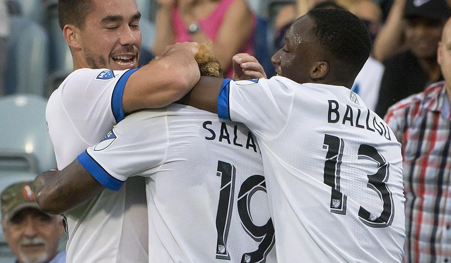 Montreal Impact's Michael Salazar (19) is hugged by teammates after scoring against the Philadelphia Union during the first half of an MLS soccer match Wednesday, July 19, 2017, in Montreal. (Peter McCabe/The Canadian Press via AP)