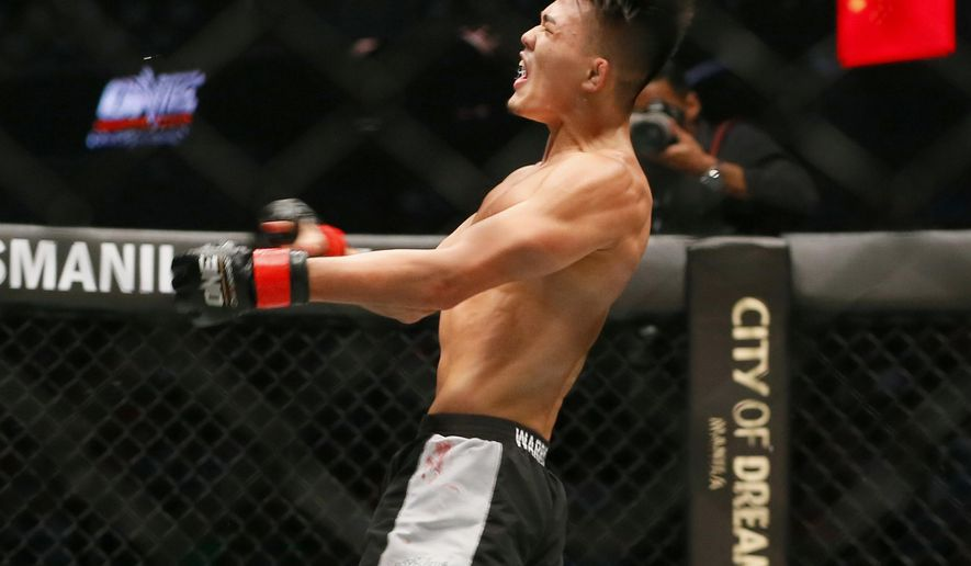 FILE - In this April 21, 2017, file photo, Singapore's Christian Lee lets out a yell following his featherweight win over China's Wan Jian Ping in a Mixed Martial Arts fight dubbed One FC (Fighting Championship), in Pasay city, south of Manila, Philippines. ONE Championship has secured a major equity investment from venture capital firm Sequoia India and investment firm Mission Holdings, positioning the Singapore-based mixed martial arts promotion to increase its presence throughout Asia. (AP Photo/Bullit Marquez, File)