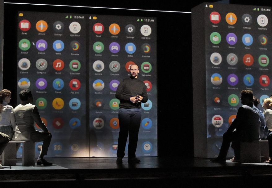 "This image released by the Santa Fe Opera shows Edward Parks as Steve Jobs in Santa Fe Opera's world premiere of Mason Bates and Mark Campbell's opera, ""The (R)evolution of Steve Jobs,"" in Santa Fe, N.M. (Ken Howard/Santa Fe Opera via AP)"