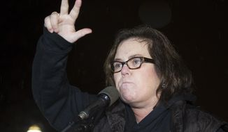 In this Feb. 28, 2017, file photo, Rosie O'Donnell speaks at a rally calling for resistance to President Donald Trump in Lafayette Park in front of the White House in Washington, prior the president's address to a joint session of Congress. Conservative blogs are criticizing O'Donnell after she tweeted a link to an online game July 15, 2017, where players can lead President Donald Trump off a cliff. (AP Photo/Cliff Owen, File)